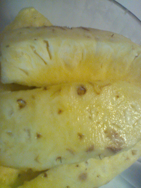 When juicing pineapple you will need to cut off outer part of fruit.