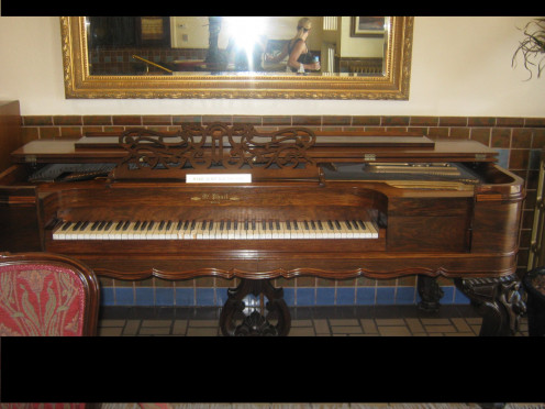 A well Preserved Upright Piano Sits In The Lobby.