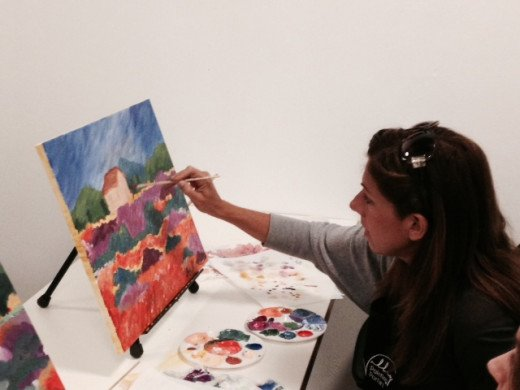 One of our students enjoying her painting of the Monet inspired landscape painting.