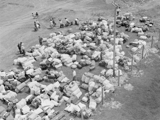 In bad and austere times, this is usually the beginning of what happens to minorities. Usually their fate is to be liquidated. In this case, this phot is of Japanese interred in US concentration camps in WWII.