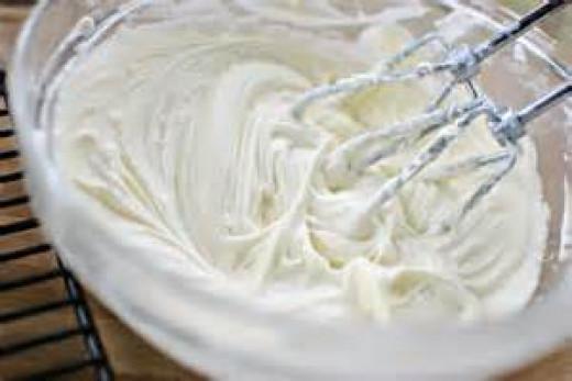 preparing cream cheese, cool whip and sugar