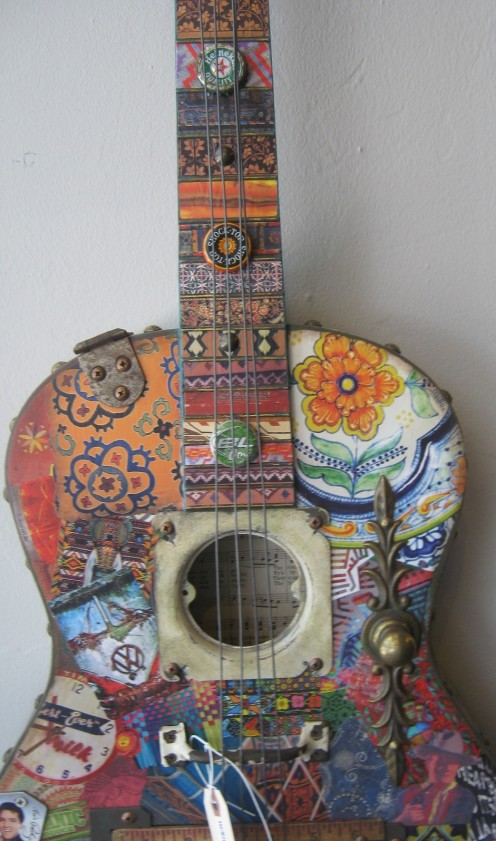 Check Out This Old Guitar That Has Been Turned Into A Hand-Painted Musical Masterpiece