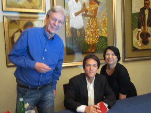 My husband, Ed and I pose with Mitch Albom (center) as he signs our books for us.
