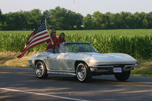 The Chevy Corvette with a flag is American.