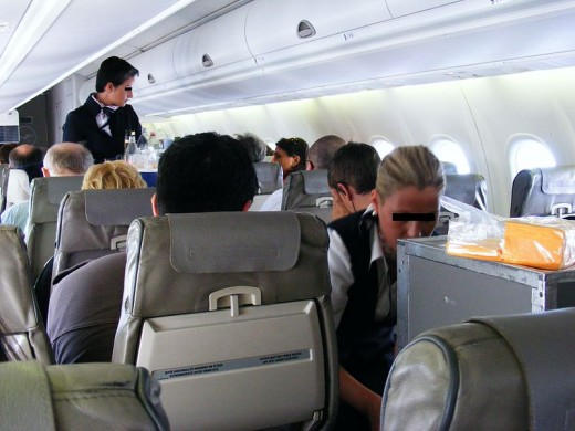 Air hostess serving snacks