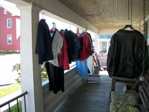 Clothes hanging on the porch for sale. Big wraparound porch was perfect for selling unwanted items.