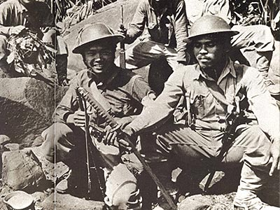 Filipino Scouts with captured Japanese Sword during the Battle of Bataan.