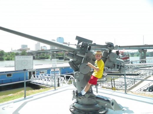 Caleb on an Anti-Aircraft Gun from the U.S.S. Razorback Submarine