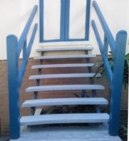 The set of concrete stairs on galvanized steel stringers have been finished, and I believe that they will last for 50 years maintenance free, I have fixed the old hand rail, as it could last for another 20 years and that will do me just fine.