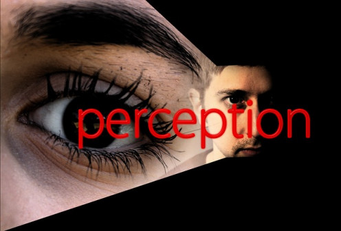 Image of a woman and a man with the word perception in red