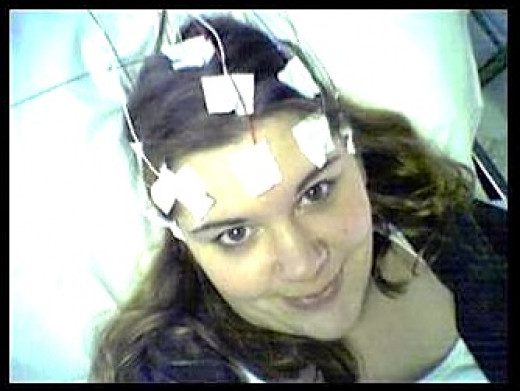 Electrodes are attached to the part of the body being tested with EEG (electroencephalography).  It is non-invasive can be made portable.