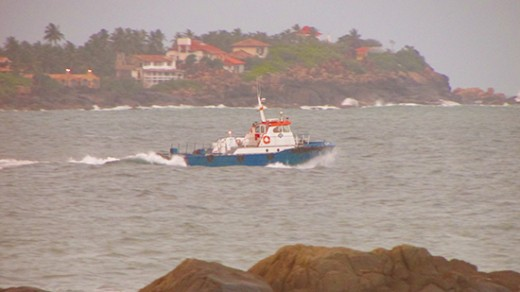 Boat leaving the harbour (shot from the Galle ramparts).