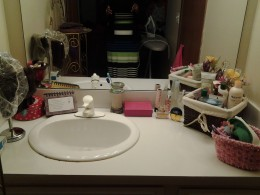 Clean Sink, Mirror and Counter Top Organized by Virginia Ballinger Looks Very Inviting.