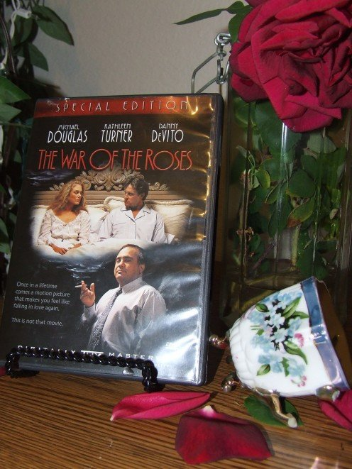 "Photo of the movie, ""War of The Roses"" A broken cup represents dysfunction in the marriage."