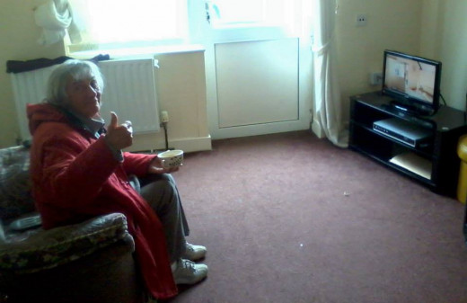 Mum in her sheltered flat watching television. She just wants a peaceful and stress-free life.