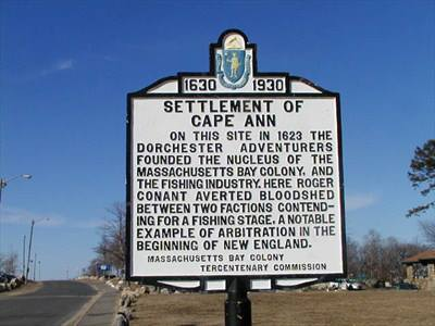 A historical marker, signifying the roots of the settlers in New England