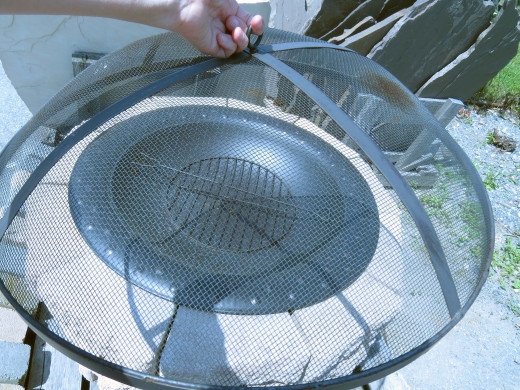 Complete fire pit kit: Enclosure, insert, grate (for wood), and screen.