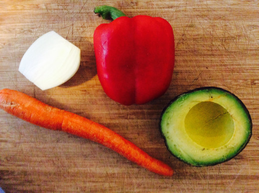 Vegetables, uncut (red bell pepper, carrot, avocado, and onion)