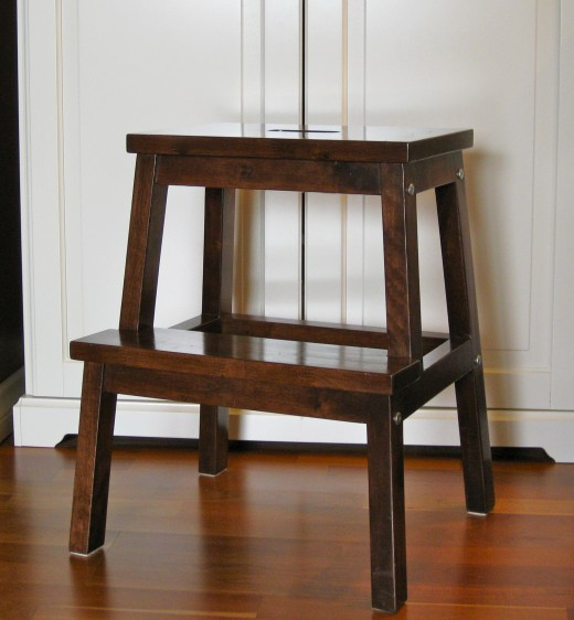 This step-stool is used as a seat, occasional table & a ladder.