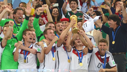 Philipp Lahm lifts the World Cup for Germany.