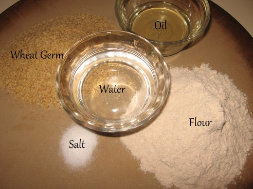 First, preheat your oven to 350 degrees.  Then, gather your five ingredients: 3/4 cup wheat germ, 3/4 cup flour, 1/2 teaspoon salt, 2 Tablespoons plus 2 teaspoons  oil, and 1/2 cup water.