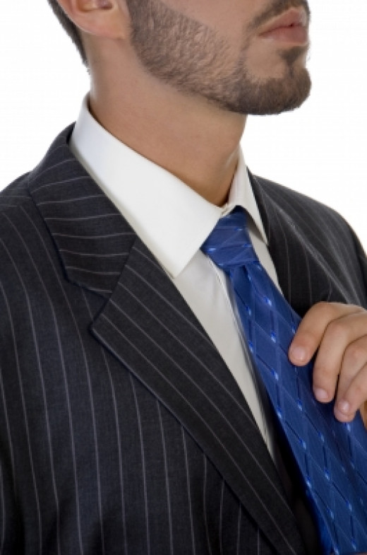 A blue tie looks great with a suit for an interview.