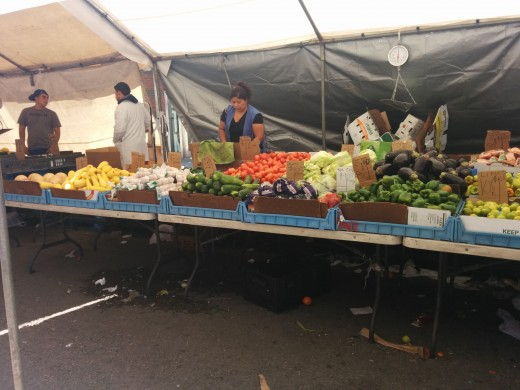 Produce sellers on a sunny Friday in Boston's Haymarket