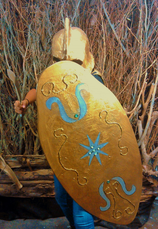Shield made from an old waterboard.BTW; the backdrop was made from several tree branches nailed to a wood board and painted in a camo scheme.
