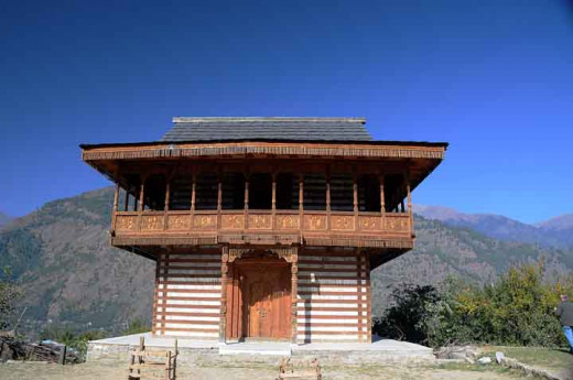 A wooden temple on the road on the left bank of River Beas near Naggar, District Kullu.