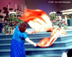 Pam Clark took this picture in 2003 at a Charlotte (NC) Healing Rooms conference with Cal Pierce. These flags are just the usual gold fabric you often see, but the camera saw them as flames!
