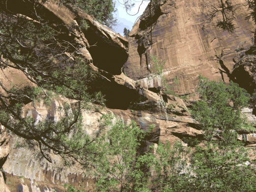 The horseshoe-shaped cliffs where the waterfall usually pours over the entire ledge during ample rain and snowmelt.