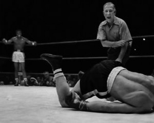 Sugar Ray Robinson knocked out the iron chinned Gene Fullmer in the fifth round with a classic, picture perfect left hook.