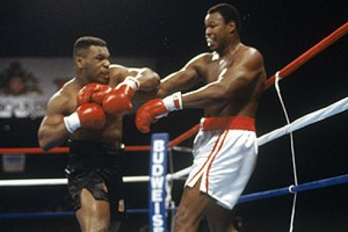 Mike Tyson knocked Larry Holmes out in four rounds in defense of his heavyweight championship.