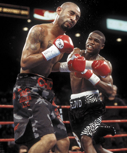 Floyd Mayweather knocked down undefeated jr. Lightweight champion Diego Corrales five times en route to winning by knockout.