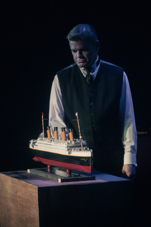 John Shelton as Thomas Andrews with the centerpiece of the show, the model of the Titanic during the show's overture.