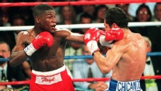 Floyd Mayweather won his first world title by knocking out Genaro Hernandez in 8 rounds.