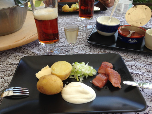 Traditional Midsummer food consists of pickled herring, boiled new potatoes, onion and sour creme.