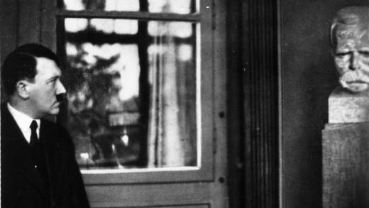 Hitler contemplating Nietzsche's bust.