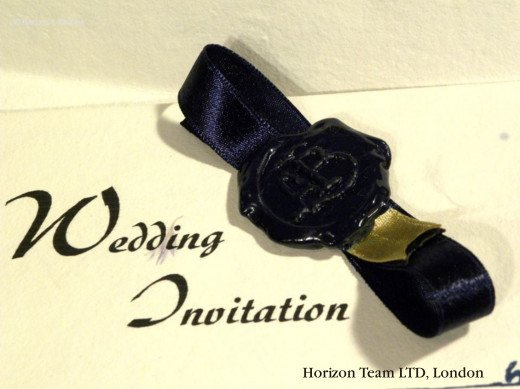 Navy Blue Wax Seal with Initials on a Navy Blue Ribbon with Gold Element (On a Romeo and Juliet Invitation)