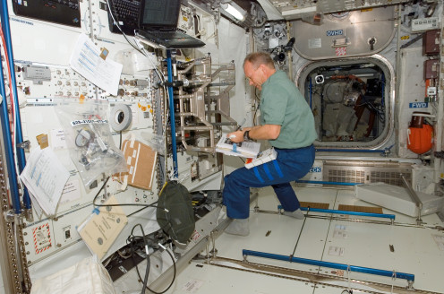European Space Agency astronaut Hans Schlegel, STS-122 mission specialist, works on the Columbus laboratory for the ISS in 2008.