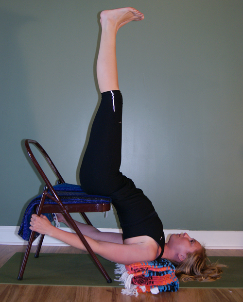 Sarvangasana - shoulderstand, with a chair - use blankets under the shoulders