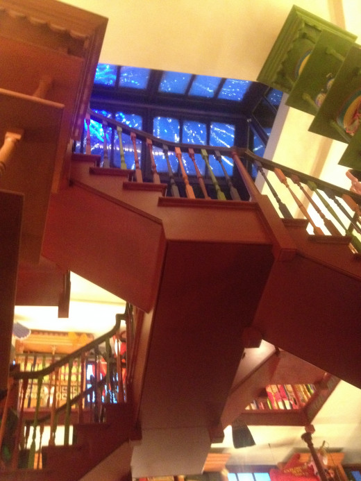 The view of the multi-level Weasley shop, straight to the firework skylights.