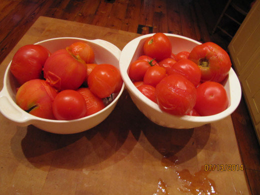 Tomatoes, Tomatoes, Tomatoes!! Here is a hint: drop tomatoes in boiling water for 30 seconds.  The peel will slide right off then you can prep them for cooking or canning.