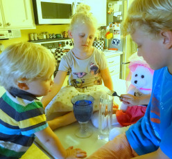 "Children accompany ""Kersploshes"" with tuned water glasses."