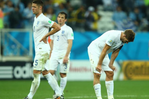 England players looking dejected after suffering World Cup 2014 exit
