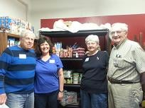 Here is a picture of my parents and my husband and I inside the storage closet of the food pantry where most of the items in there have been bought and donated by my husband and I after combining coupons and sales. I am having so much fun with this!