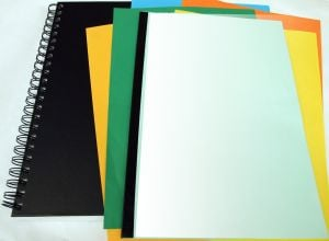 Notebook and colored papers and folders