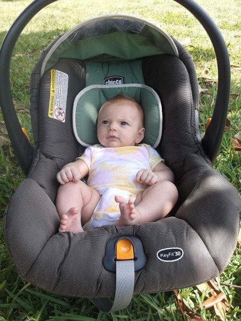This Chicco infant car seat doubles as a carrier fitting into a base that stays fastened in the car, or can be placed into the corresponding stroller as part of a travel system