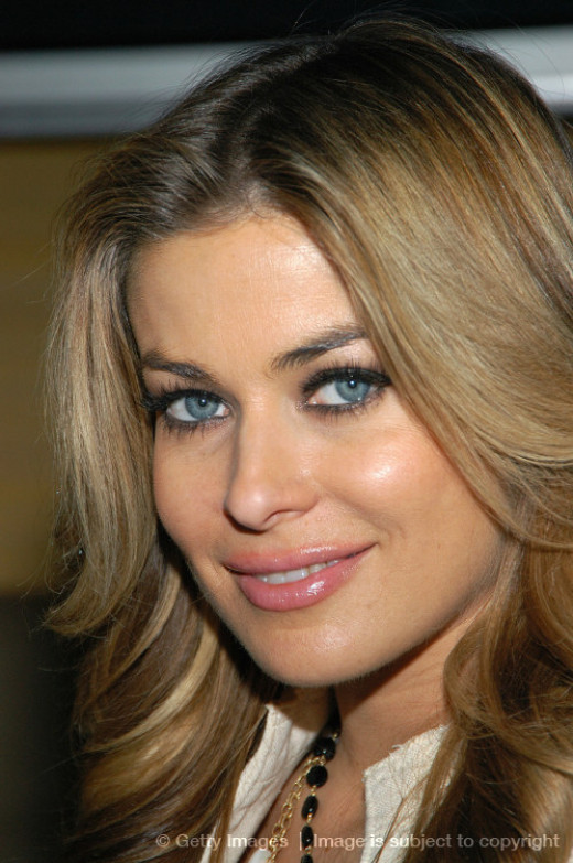 Carmen Electra worked as a stripper prior to becoming famous and at a local theme park in Ohio called King's Island where she was also a dancer but kept her clothes on there.