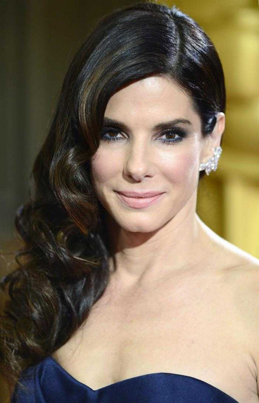 Sandra Bullock was a cocktail waitress and a bartender prior to making it big in Hollywood.  She also was a coat checker.  Definitely a step up from where she was.